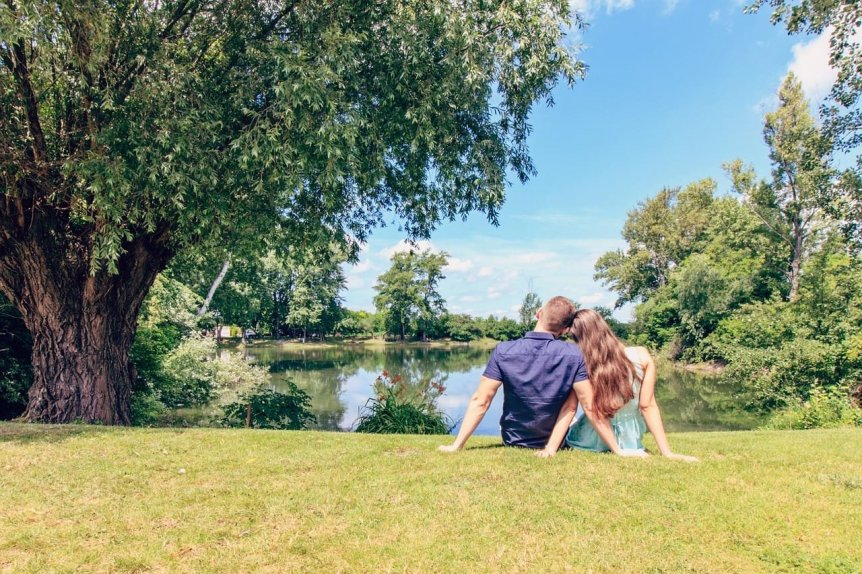 couple by pond